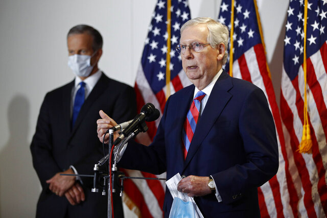 Senate Majority Leader Mitch McConnell of Ky., speaks at a news conference on Capitol Hill in Washington, Tuesday, May 12, 2020. Standing behind McConnell is Senate Majority Whip John Thune, R-S.D. (AP Photo/Patrick Semansky)