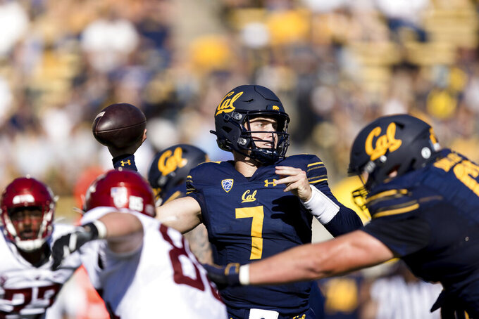 California quarterback Chase Garbers (7) passes against Washington State in the second quarter of an NCAA college football game in Berkeley, Calif., Saturday, Oct. 2, 2021. (AP Photo/John Hefti)