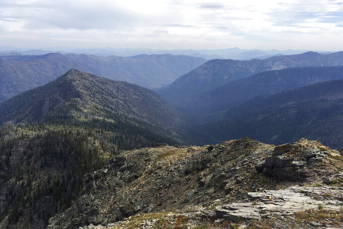 FILE - In this August 2016, file photo, is the view into the Bunker Creek drainage from the Swan Ridge Alpine Trail near Swan Lake, Montana. The U.S. Forest Service has given preliminary approval to a plan for road building, logging and other forest management on Forest Service land in Montana's Swan Valley. The agency says the goal is to reduce wildfire dangers and enhance habitat for federally protected species such as Canada lynx, bull trout and whitebark pine trees. (Sam Wilson/The Daily Inter Lake via AP, File)