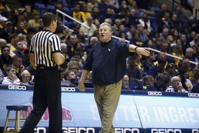 West Virginia head coach Bob Huggins yells at a referee during the first half of an NCAA college basketball game Saturday against Oklahoma, Feb. 2, 2019, in Morgantown, W.Va. (AP Photo/Raymond Thompson)