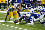 Green Bay Packers' Marquez Valdes-Scantling (83) fumbles a catch during the overtime of an NFL football game against the Indianapolis Colts, Sunday, Nov. 22, 2020, in Indianapolis. Indianapolis Colts' DeForest Buckner (99) recovered the fumble. (AP Photo/Michael Conroy)