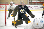 Pittsburgh Penguins goalie Tristan Jarry, center, participates in the team's first NHL hockey practice of the season in Cranberry, Pa., Thursday, Sept. 23, 2021. (AP Photo/Gene J. Puskar)