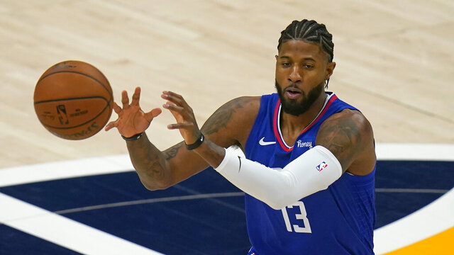 Los Angeles Clippers guard Paul George receives a pass during the first half of the team's NBA basketball game against the Utah Jazz on Friday, Jan. 1, 2021, in Salt Lake City. (AP Photo/Rick Bowmer)
