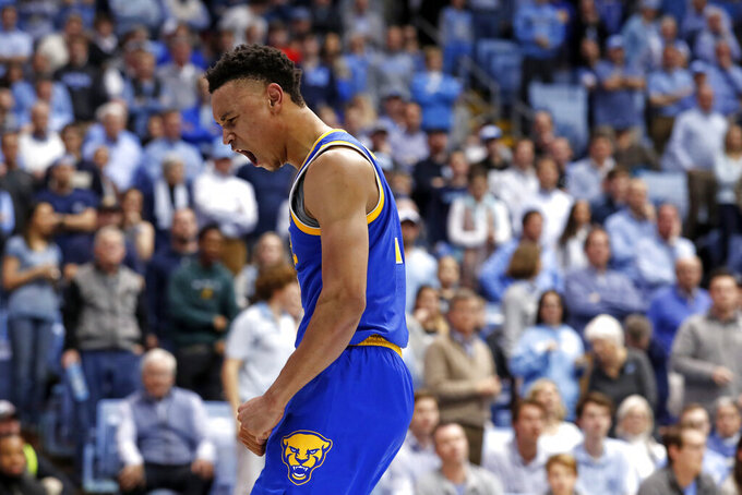 Pittsburgh guard Trey McGowens (2) reacts following a basket against North Carolina during the second half of an NCAA college basketball game in Chapel Hill, N.C., Wednesday, Jan. 8, 2020. (AP Photo/Gerry Broome)