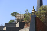 Construction of a mausoleum where former Zimbabwean President Robert Mugabe was supposed to be buried continues at the National Heroes Acre, in Harare, Friday, Sept, 27, 2019. Zimbabwe's former president Mugabe will now be buried at his rural home, according to a government spokesperson. Mugabe's burial location has been a source of mystery and contention since his death earlier this month at age 95 in Singapore. (AP Photo/Tsvangirayi Mukwazhi)