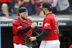 Cleveland Indians' Roberto Perez, left, and relief pitcher Oliver Perez celebrate after the Indians defeated the Minnesota Twins 7-5 in a baseball game, Sunday, Sept. 15, 2019, in Cleveland. (AP Photo/Tony Dejak)