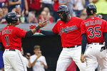 Cleveland Indians' Franmil Reyes, center, is congratulated by Jose Ramirez and Oscar Mercado after hitting a three-run home run in the third inning of a baseball game against the Tampa Bay Rays, Thursday, July 22, 2021, in Cleveland. (AP Photo/Tony Dejak)