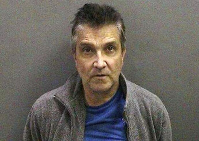 FILE - This 2013 file photo released by the Orange County District Attorney's Office shows Lonnie Loren Kocontes. Kocontes, a former Southern California lawyer was sentenced to life without the possibility of parole for strangling his ex-wife and throwing her body off a cruise ship in the Mediterranean in 2006. Lonnie Loren Kocontes was sentenced Friday, Sept. 18, 2020, after being convicted in June of first-degree murder with a special circumstances enhancement of murder for financial gain.(Orange County District Attorney's Office via AP, File)