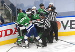 Dallas Stars and Tampa Bay Lightning players fight during the third period of Game 3 of the NHL hockey Stanley Cup Final, Wednesday, Sept. 23, 2020, in Edmonton, Alberta. (Jason Franson/The Canadian Press via AP)