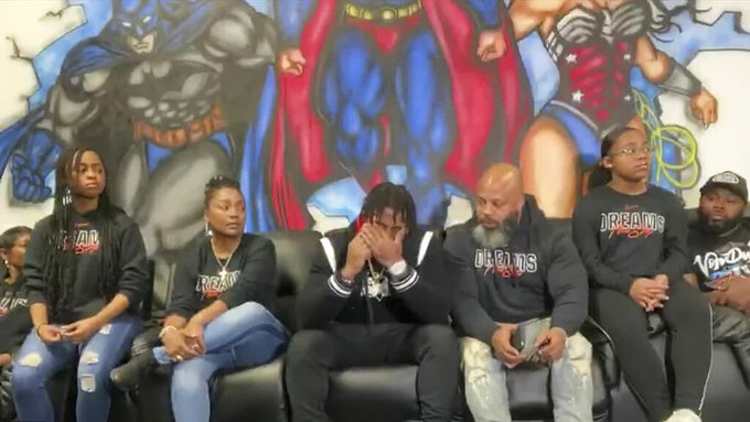 In this still image from video provided by the NFL, D'Andre Swift, center, reacts as he's selected by the Detroit Lions during the second round of the NFL football draft, Friday, April 24, 2020. (NFL via AP)