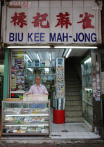 In this April 18, 2019, photo, Cheung Shun-king, 65-year-old maker of the popular table-top game mahjong tiles, poses in his 100 square foot, decades-old store in Kowloon's old neighborhood of Hong Kong. Hand-carved mahjong tiles is a dying art in Hong Kong. (AP Photo/Kin Cheung)