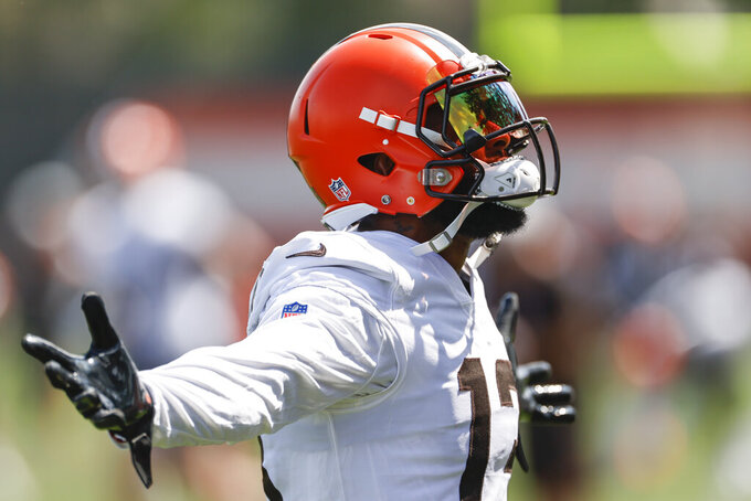 Cleveland Browns wide receiver Odell Beckham Jr. reacts after breaking up a pass during a drill during an NFL football practice Thursday, Aug. 12, 2021, in Berea, Ohio. (AP Photo/Ron Schwane)