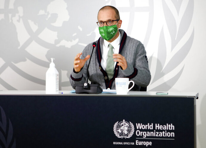 "World Health Organization regional director Dr. Hans Kluge speaks during an online news conference with Katie Smallwood, WHO Europe's senior health emergency officer, in Copenhagen, Denmark, on Thursday Sept. 17, 2020. Kluge said his decision to wear a mask was ""a clear signal that we are going into a worsening situation"" with the coronavirus in WHO Europe's 53-country region. (David Barrett/WHO via AP)"