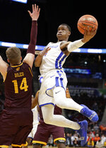 Buffalo's Davonta Jordan (4) drives to the basket against Central Michigan's David DiLeo (14) during the second half of an NCAA college basketball game in the semifinals of the Mid-American Conference men's tournament Friday, March 15, 2019, in Cleveland. Buffalo won 85-81. (AP Photo/Tony Dejak)