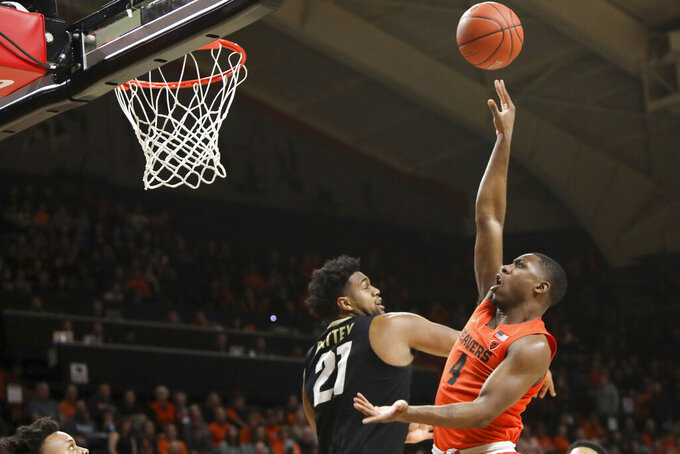 Oregon State's Alfred Hollins (4) shoots over Colorado's Evan Battey (21) during the first half of an NCAA college basketball game in Corvallis, Ore., Saturday, Feb. 15, 2020. (AP Photo/Amanda Loman)