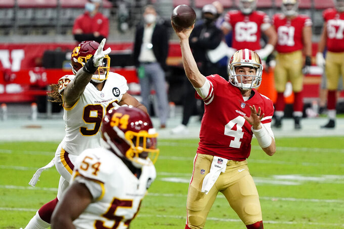San Francisco 49ers quarterback Nick Mullens (4) throws against the Washington Football Team during the first half of an NFL football game, Sunday, Dec. 13, 2020, in Glendale, Ariz. (AP Photo/Rick Scuteri)