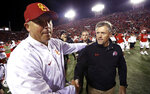 Utah head coach Kyle Whittingham, right, shakes hands with Southern California head coach Clay Helton following their NCAA college football game Saturday, Oct. 20, 2018, in Salt Lake City. (AP Photo/Rick Bowmer)