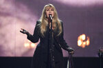 FILE - This March 29, 2019 file photo shows Stevie Nicks performing at the Rock & Roll Hall of Fame induction ceremony in New York. The Who, Lizzo and Foo Fighters will join Stevie Nicks, Lionel Richie, Lenny Kravitz, The Avett Brothers and Elvis Costello at the 2020 New Orleans Jazz and Heritage Festival. (Photo by Evan Agostini/Invision/AP, File)