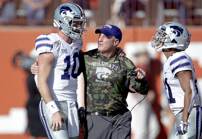 Kansas State quarterback Skylar Thompson (10) talks with head coach Chris Klieman, center, after throwing a touchdown pass against Texas during an NCAA college football game Saturday, Nov. 9, 2019, in Austin, Texas. (Nick Wagner/Austin American-Statesman via AP)