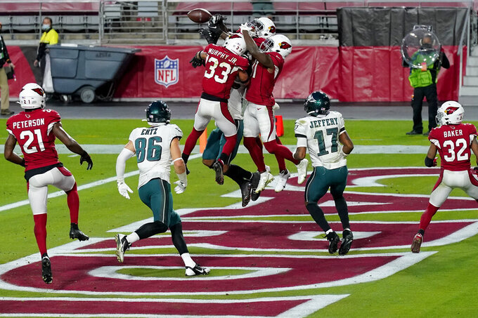 Arizona Cardinals cornerback Byron Murphy (33), free safety Chris Banjo, right, break up a Philadelphia Eagles final pass attempt with no time on the clock during the second half of an NFL football game, Sunday, Dec. 20, 2020, in Glendale, Ariz. The Cardinals won 33-26. (AP Photo/Ross D. Franklin)