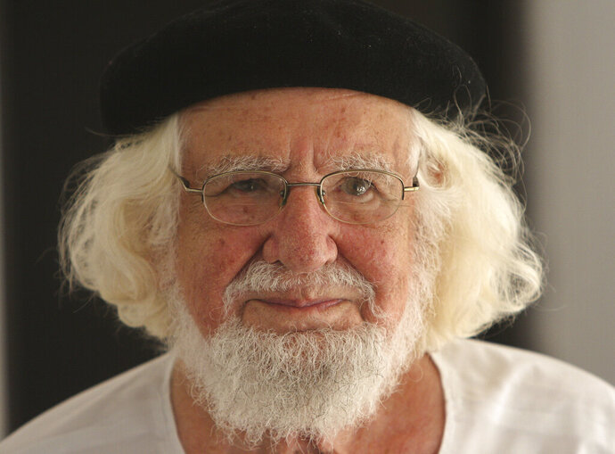 FILE - This Aug. 29, 2008 file photo shows Nicaraguan priest and poet Ernesto Cardenal in his home while under house arrest, in Managua, Nicaragua. The Vatican's ambassador to Nicaragua said Monday, Feb. 18, 2019, that Pope Francis has lifted the suspension imposed in 1983 on Cardenal. Pope John Paul II suspended Cardenal from his priestly duties because he had become culture minister in the leftist Sandinista government of Daniel Ortega. (AP Photo/Esteban Felix, File)