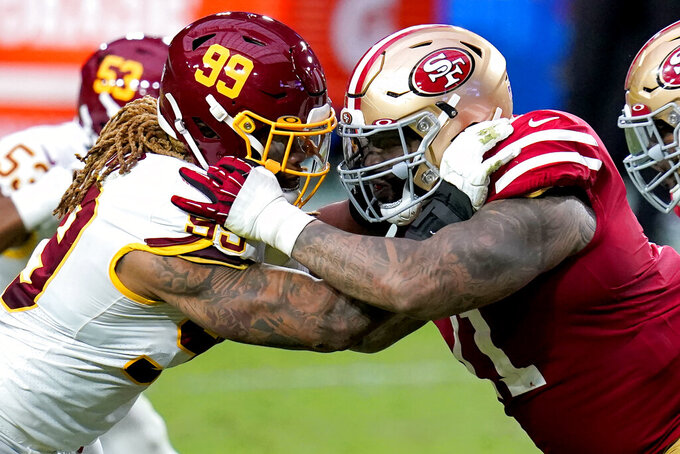 Washington Football Team defensive end Chase Young (99) and San Francisco 49ers offensive tackle Trent Williams battle during the first half of an NFL football game, Sunday, Dec. 13, 2020, in Glendale, Ariz. (AP Photo/Ross D. Franklin)