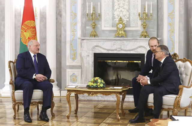 Belarusian President Alexander Lukashenko, left, speaks with International Ice Hockey Federation President Rene Fasel during their meeting in Minsk, Belarus, Monday, Jan. 11, 2021. (Nikolai Petrov/BelTA Pool Photo via AP)