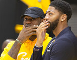 Los Angeles Lakers NBA basketball players, LeBron James, left, and Anthony Davis share a moment after David was introduced at a news conference at the UCLA Health Training Center in El Segundo, Calif., Saturday, July 13, 2019. (AP Photo/Damian Dovarganes)