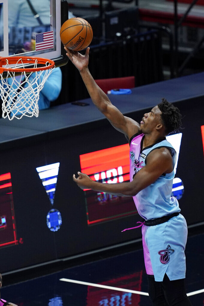 Miami Heat forward Jimmy Butler (22) drives to the basket during the first half of an NBA basketball game against the Sacramento Kings, Saturday, Jan. 30, 2021, in Miami. (AP Photo/Marta Lavandier)