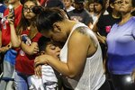 Jessica Luna hugs her son Julien Lucero, 6, while both of them cry during a vigil at Ponder Park in honor to the victims of a mass shooting occurred in Walmart on Saturday morning in El Paso on Sunday, August 4, 2019. (Lola Gomez/Austin American-Statesman via AP)
