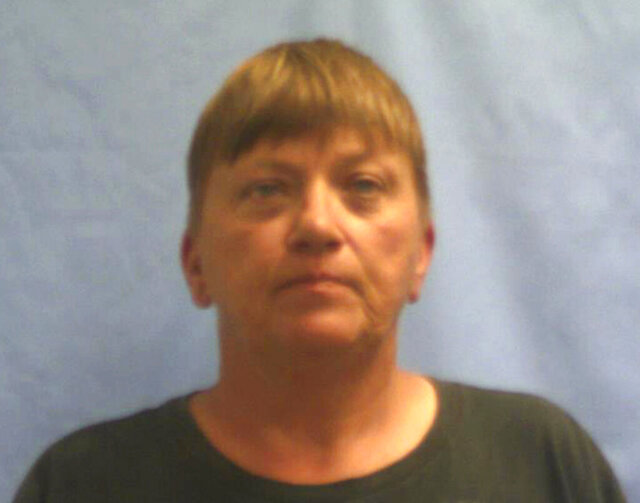 This undated photo provided by the Crawford County Jail in Van Buren, Ark., shows Kimberly Younger. Younger, suspected in the killings of a Kansas couple who were working as carnival vendors pleaded not guilty to several charges Wednesday, Feb. 19, 2020, in the death of Alfred and Pauline Carpenter, who were working as vendors at the Barton County Fair in July 2018 when they were killed, driven to Arkansas and buried. (Crawford County Jail via AP)