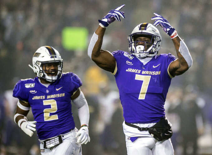 James Madison defensive lineman John Daka (7), right, and linebacker Dimitri Holloway (2) celebrate after making a sack during the first half of a quarterfinal game against Northern Iowa in the NCAA college Football Championship Subdivision playoffs in Harrisonburg, Va., Friday, Dec. 13, 2019. (Daniel Lin/Daily News-Record via AP)