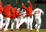 Boston Red Sox's Rafael Devers is congratulated by teammates after his walk-off single against the Toronto Blue Jays during a baseball game Thursday, April 11, 2019, at Fenway Park in Boston. Boston won 7-6. (AP Photo/Winslow Townson)