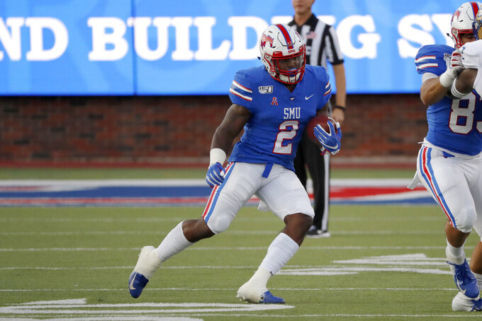 SMU linebacker Patrick Nelson advances the ball during the first half of an NCAA college football game against Tulsa, Saturday, Oct. 5, 2019, in Dallas, Texas. (AP Photo/Roger Steinman)
