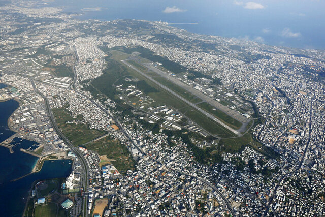 FILE - This October 2015, aerial file photo shows U.S. Marine Corps Air Station Futenma in Ginowan, Okinawa, southern Japan. Japanese defense minister said on Tuesday, July 14, 2010 that officials have discovered