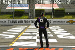 FILE - In this June 28, 2020, file photo, Jimmie Johnson stands near the start-finish line before the start of the NASCAR Cup Series auto race at Pocono Raceway in Long Pond, Pa. This year has hardly been the farewell tour Jimmie Johnson envisioned when he said 2020 would be his final season of full-time NASCAR racing. The seven-time champion has had to say his goodbyes at empty race tracks absent of all fanfare and now his streak of 663 consecutive races has ended because Johnson tested positive for the coronavirus.(AP Photo/Matt Slocum, File)