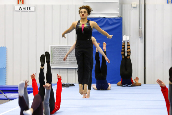 Laurie Hernandez trains with other USA gymnasts in Indianapolis, Monday, Jan. 20, 2020. Hernandez, a two-time Olympic medalist, and other veterans in the USA Gymnastics elite program have praised the organization for taking steps to become more accountable and transparent in the wake of the Larry Nassar scandal. (AP Photo/Teresa Crawford)
