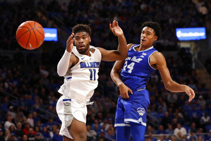 Seton Hall's Jared Rhoden (14) passes around Saint Louis' Hasahn French (11) during the first half of an NCAA college basketball game Sunday, Nov. 17, 2019, in St. Louis. (AP Photo/Jeff Roberson)