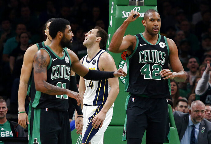 Boston Celtics' Al Horford (42) pumps his fist after being fouled while making a basket by Indiana Pacers' Bojan Bogdanovic, rear, during the second quarter in Game 1 of a first-round NBA basketball playoff series, Sunday, April 14, 2019, in Boston. (AP Photo/Winslow Townson)