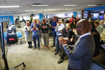 The staff of the Cincinnati Enquirer gather to celebrate in their newsroom after learning the newspaper won the Pulitzer Prize for Local Reporting for