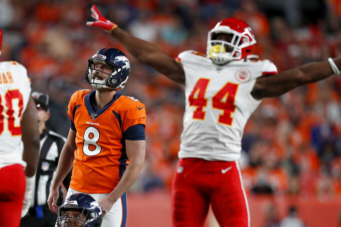Kansas City Chiefs linebacker Dorian O'Daniel (44) reacts as Denver Broncos kicker Brandon McManus (8) misses a field goal attempt during the first half of an NFL football game, Thursday, Oct. 17, 2019, in Denver. (AP Photo/David Zalubowski)