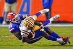Florida linebacker Ventrell Miller (51) tackles LSU wide receiver Koy Moore after a reception during the first half of an NCAA college football game Saturday, Dec. 12, 2020, in Gainesville, Fla. (AP Photo/John Raoux)