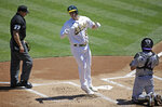 Oakland Athletics' Matt Chapman steps off home plate after hitting a home run off Colorado Rockies pitcher German Marquez in the first inning of a baseball game Wednesday, July 29, 2020, in Oakland, Calif. At right is Rockies' catcher Tony Wolters. (AP Photo/Ben Margot)