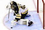 Boston Bruins goaltender Jaroslav Halak (41) covers up the puck during the second period against the Tampa Bay Lightning in Game 1 of an NHL hockey second-round playoff series, Sunday, Aug. 23, 2020, in Toronto. (Frank Gunn/The Canadian Press via AP)
