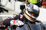 Ed Carpenter climbs out of his car during practice for the Indianapolis 500 auto race at Indianapolis Motor Speedway, Wednesday, May 19, 2021, in Indianapolis. (AP Photo/Darron Cummings)