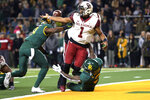 Oklahoma quarterback Jalen Hurts (1) fumbles the ball while getting tackled by Baylor safeties Henry Black (8) and Chris Miller (3) during an NCAA college football game, Saturday, Nov. 16, 2019, in Waco, Texas. Oklahoma won 34-31. (Ian Maule/Tulsa World via AP)