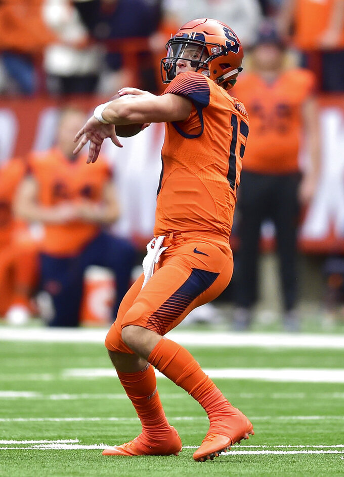 Syracuse quarterback Tommy DeVito (13) passes against North Carolina during an NCAA college football game, Saturday, Oct. 20, 2018, in Syracuse, N.Y. (Scott Schild/The Post-Standard via AP)