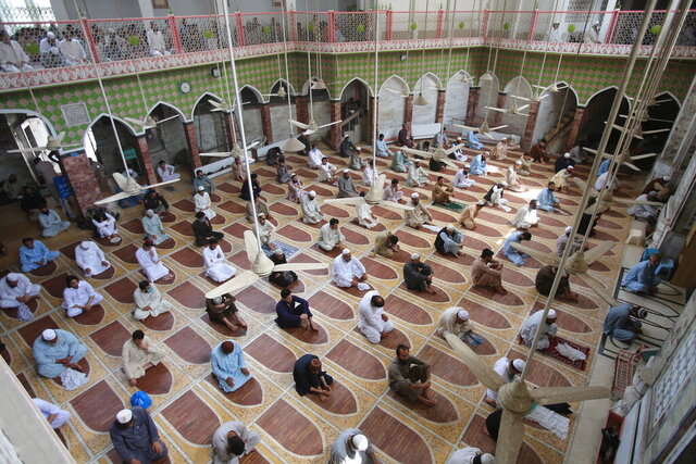 People offer Friday prayers maintain social distance at a mosque in Peshawar, Pakistan, May 1, 2020. The government imposed a nationwide lockdown to try to contain the outbreak of the coronavirus. (AP Photo/Muhammad Sajjad)