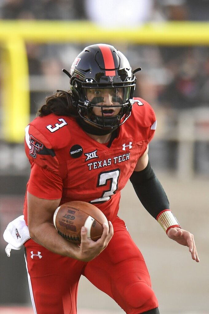 Texas Tech quarterback Henry Colombi (3) runs the ball during the first half of the team's NCAA college football game against Baylor in Lubbock, Texas, Saturday, Nov. 14, 2020. (AP Photo/Justin Rex)