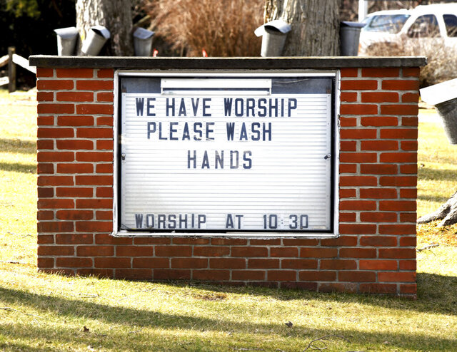 A friendly reminder regarding personal hygiene in light of the spreading coronavirus was posted on the Austinburg First United Church in Austinburg Township, Ohio, bulletin board on Monday March 16, 2020. (Warren Dillaway/The Star-Beacon via AP)